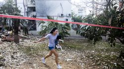 A woman in Ashdod, Israel, held her dog as she ran for a shelter after hearing sirens warning of rockets fired from the Gaza Strip on Monday.