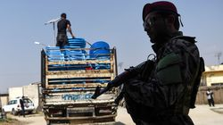 Security personnel stands guard as Independent Election Commission workers unload ballot boxes from a truck to be taken to a counting center the day after Afghanistan held presidential elections, in September, 2019.