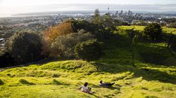 A father and son enjoyed a slide in Auckland, New Zealand's largest city. More than 50,000 people have escaped the pandemic by moving back to New Zealand.