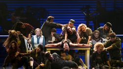 """Elizabeth Stanley (seated near table at left) and Celia Rose Gooding (seated at right), with the ensemble of """"Jagged Little Pill"""" at the Broadhurst Theater in New York. The musical, which premiered at the American Repertory Theater in Cambridge, received 15 Tony nominations, the most for any show."""