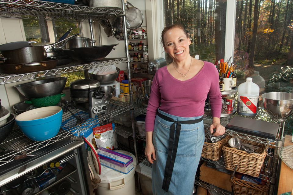 Surrounded by cookbooks, Dede Wilson tests and develops recipes in Shutesbury, while her website has offices in the South End's Food Loft.