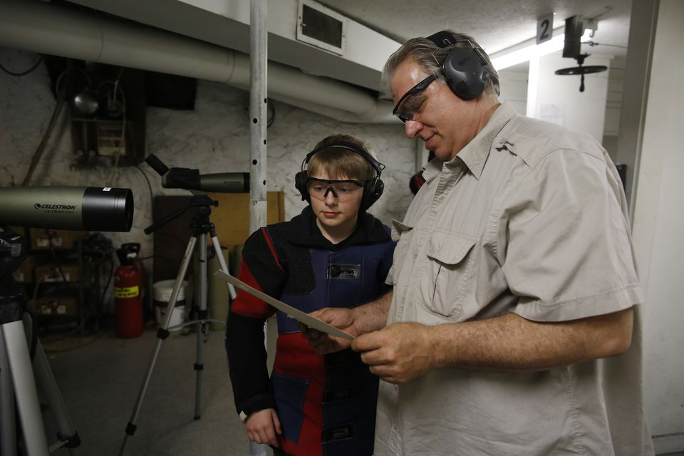 "Rio Ferguson, (left), and his father, Jay (right), both enjoy guns. ""I just like to shoot,"" Rio says. ""I just like holding that beautiful creation in my hands."" Rio also plays tennis, practices his yo-yo, and fishes."