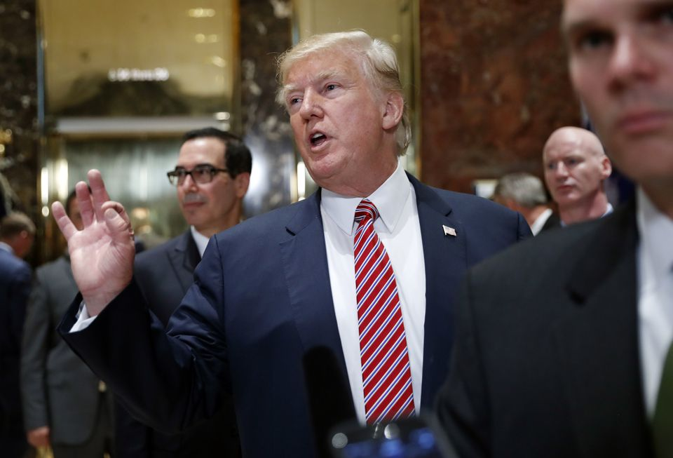 President Donald Trump gestured as he answered reporters' questions in the lobby of Trump Tower on Tuesday.
