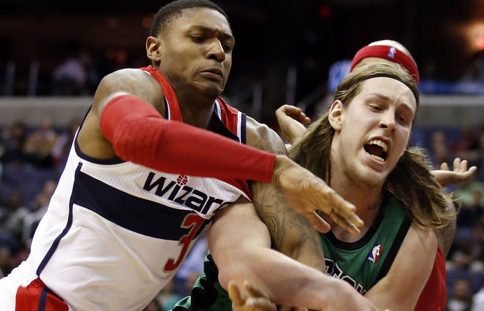 Washington's  Bradley Beal and Kelly Olynyk got tangled up as they went for the ball Wednesday.