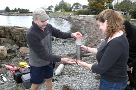 Phil Colarusso, EPA sea grass research diver, and Juliet Simpson, a marine ecologist from MIT's Sea Grant program, took samples mud samples.