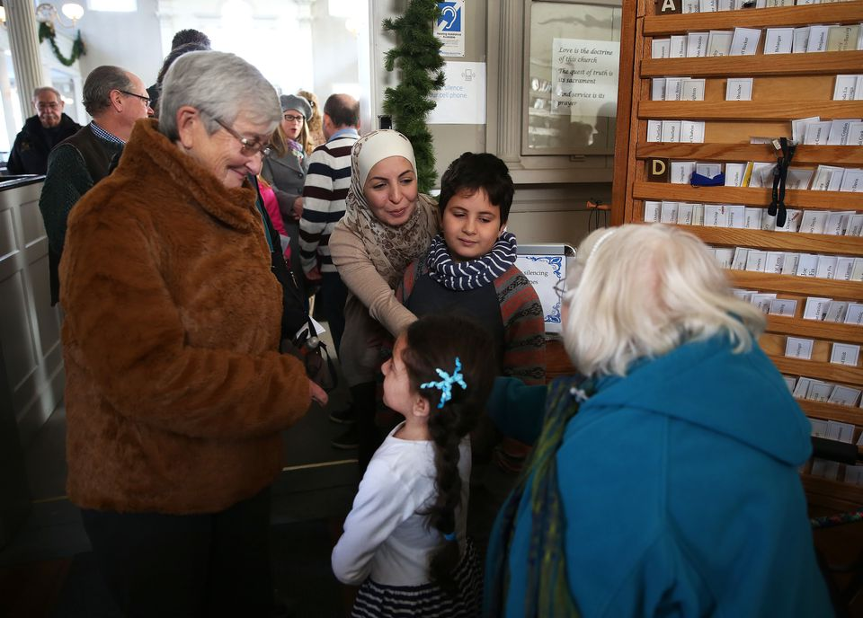 Syrian refugee Amira Elamri (center) and her family are greeted after she addressed the congregation of the First Religious Society Unitarian Universalist in Newburyport in January.