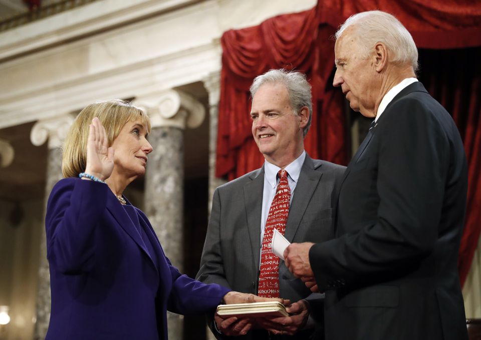 Vice President Joe Biden (right) administered the Senate oath of office to Senator Maggie Hassan as her husband held a bible, during a mock swearing in ceremony in the Old Senate Chamber on Capitol Hill in Washington.