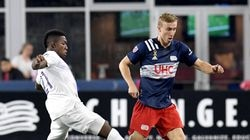 Adam Buksa (right) tries to out maneuver Orlando City's Andres Perea as the league-leading Revolution won Saturday night at Gillette Stadium.