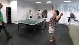 Customer service representative Angela Colon (right) and her partner beat CEO Ray Hendrickson and copywriter Pegge Bochynski in Christian Book Distributors' annual Ping-Pong tournament.