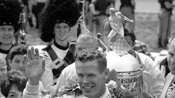 Bobby Unser acknowledges the fans after winning his first Indianapolis 500 in 1968.