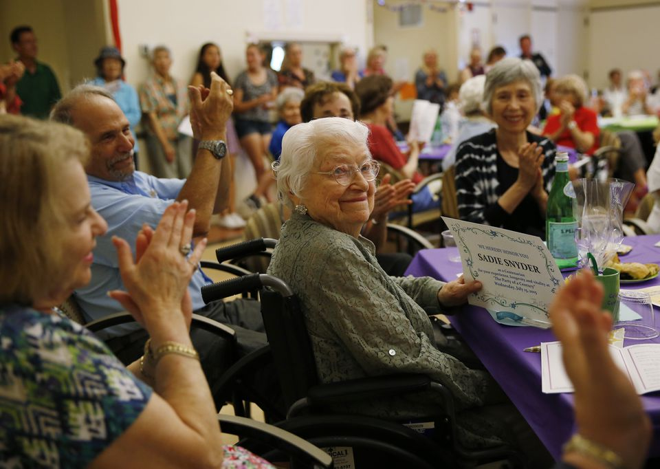 """Sadie Snyder, 105, smiled as she received an award for being a Centenarian during """"The Party of a Century."""""""