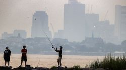 Wild fires out west made for a hazy evening fishing in Squantum with the Boston skyline in the backround.