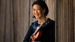 """BSO violinist Lucia Lin, photographed at home in Brookline, initially set out to create a pandemic project. Her """"In Tandem"""" series evolved into something much more."""