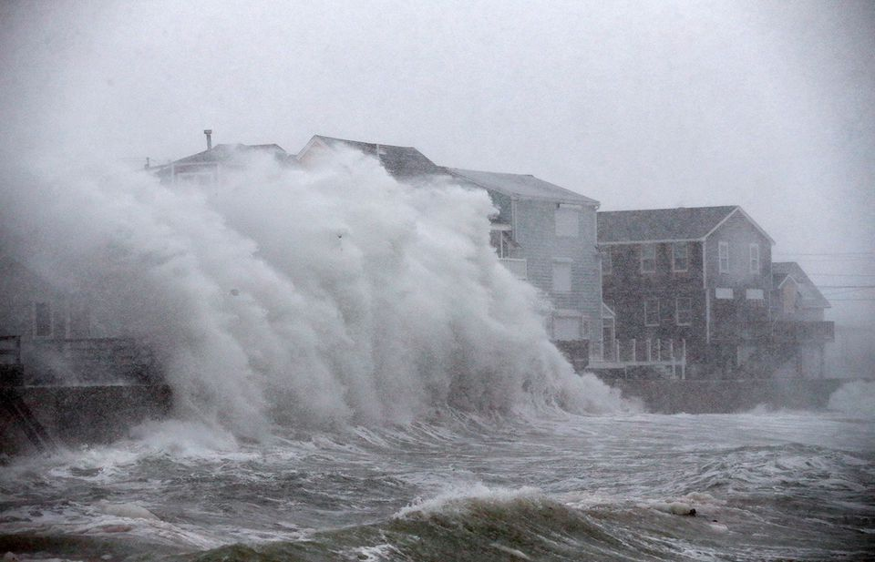 Waves crashed against homes on Turner Road in Scituate during a January storm.