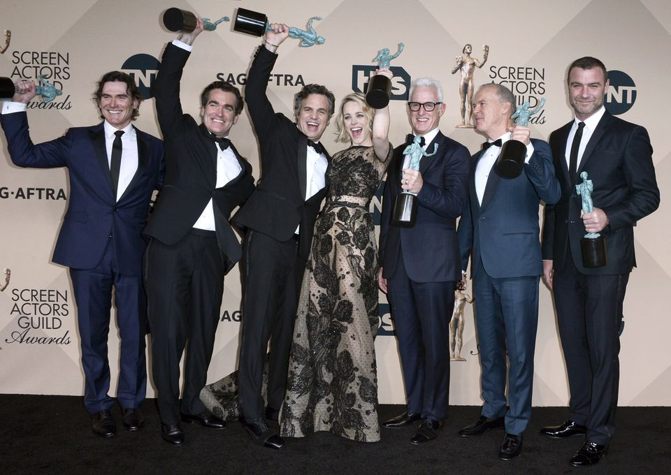 """From left: Billy Crudup, Brian d'Arcy James, Mark Ruffalo, Rachel McAdams, John Slattery, Michael Keaton, and Liev Schreiber posed with the Screen Actors Guild Award for best cast performance in """"Spotlight."""""""