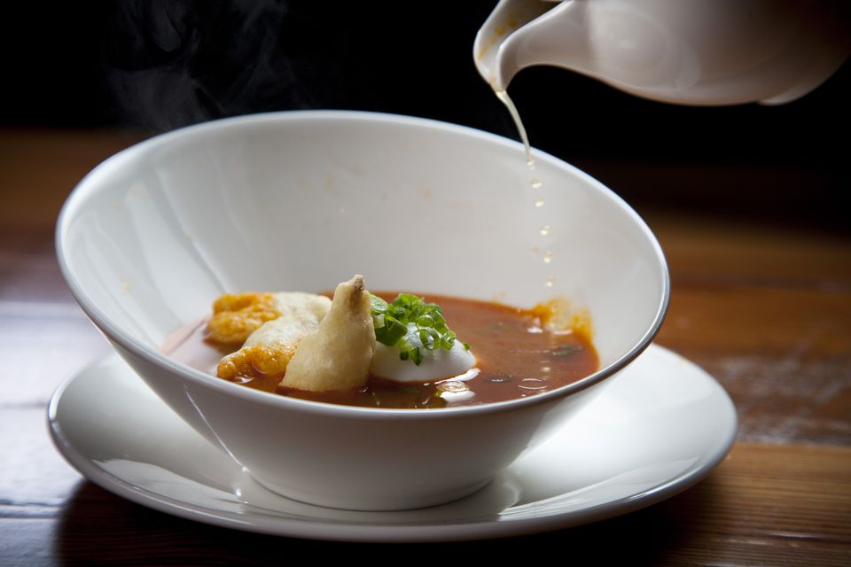 Hot and sour soup with breaded shiitake mush-rooms and poached egg.
