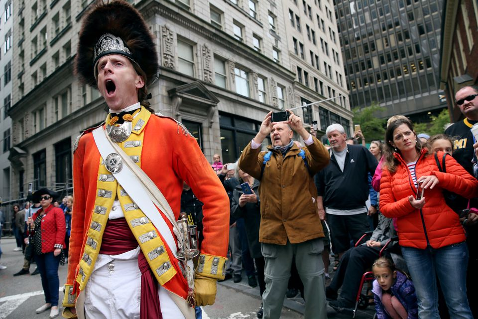 Spectaors listened as reenactor Capt. Jeffery Meriwether cheered the King at the Old State House.