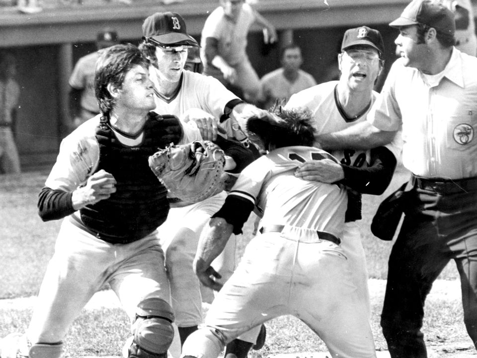 Carlton Fisk, left, and Thurmon Munson, center, engaged in a fight at home plate.