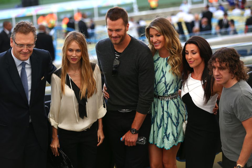 From left: FIFA's Jerome Valcke, Vanessa Lorenzo, Tom Brady, Gisele Bundchen, an unidentified guest, and Carles Puyol at the World Cup final in Brazil. Right: Brady and Bundchen before the game.
