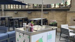 The Tipsy Scoop cart on the patio of the Precinct Kitchen + Bar at the Loews Boston Hotel is serving up flavors like dark chocolate whiskey salted caramel and vanilla bean bourbon through the end of summer.