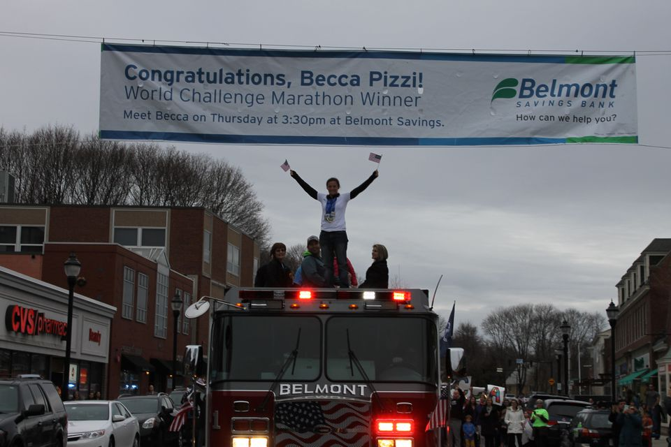 Becca Pizzi and her family rode through Belmont atop a fire truck.