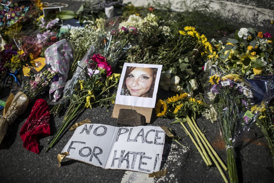 A memorial for Heather Heyer at the scene where she was killed when a man drove into a crowd during a protest against a rally of white nationalists in Charlottesville, Va.