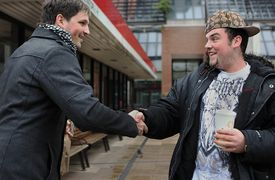 Microsoft employee Stephen Nelson (left) greeted Blake Boston when he recognized him recently in Cambridge.