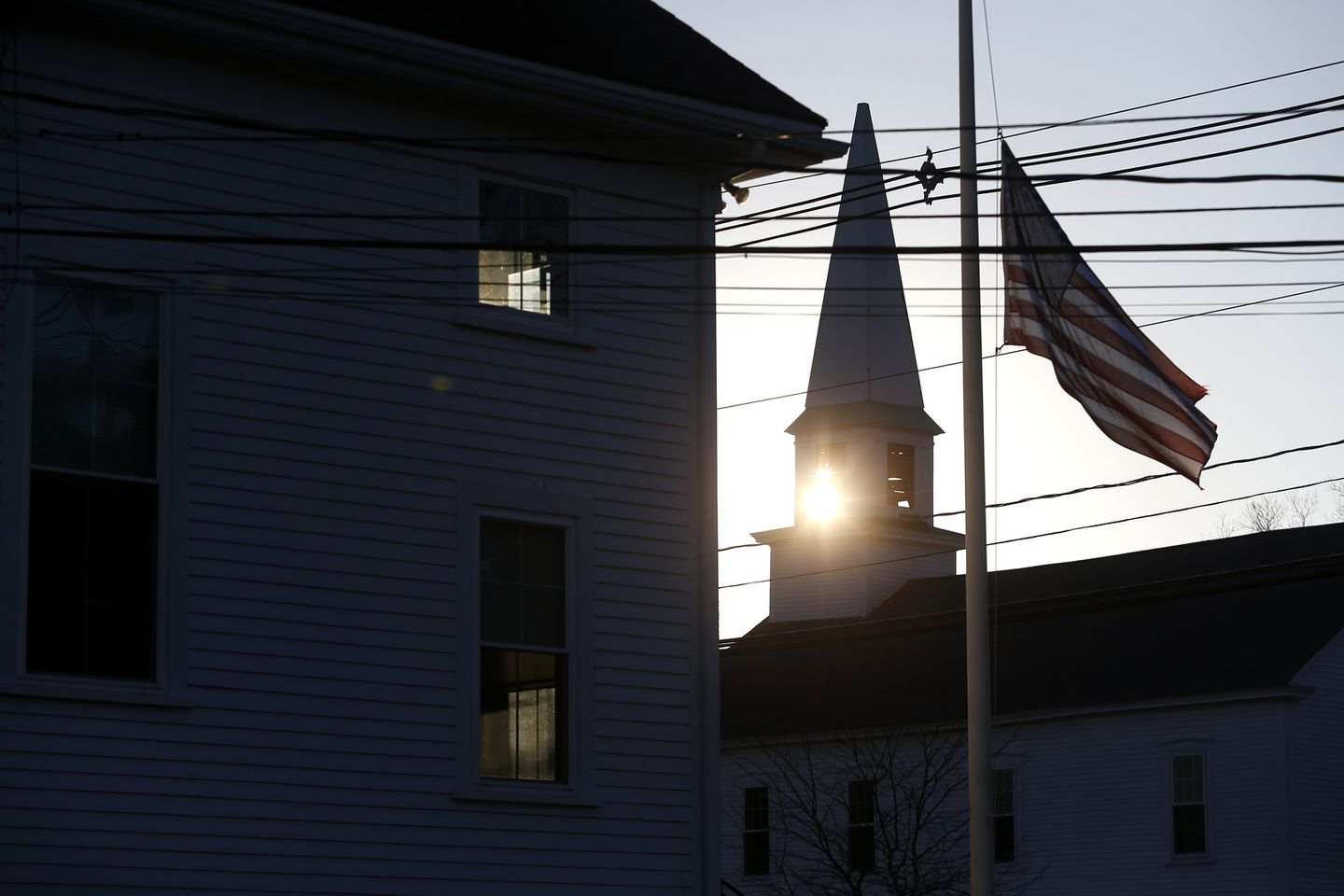 The sun set behind the steeple of United Church of Christ, Congregational in Boxborough.