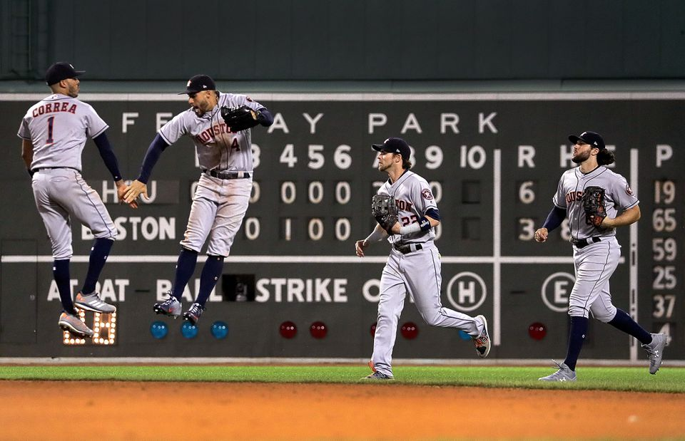 Carlos Correa and George Springer kick-start the celebration after the Astros beat the Red Sox.
