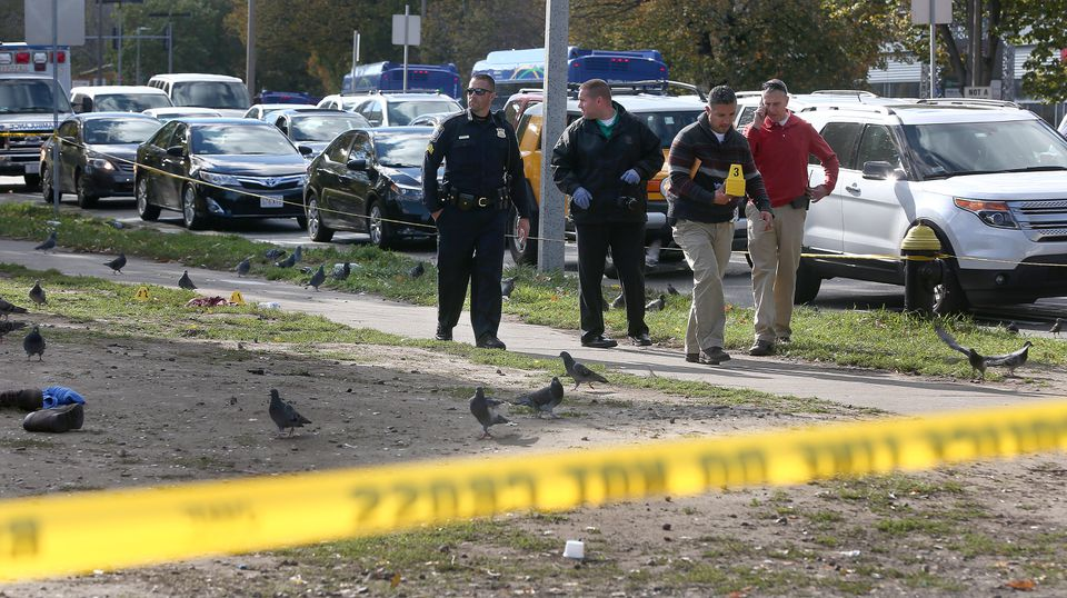 Boston police investigated the scene at the corner of Melnea Cass Boulevard and Massachusetts Avenue on Monday.