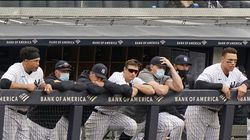 New York Yankees players lean on the dugout railing during the seventh inning of a 4-2 loss to the Tampa Bay Rays on Sunday.