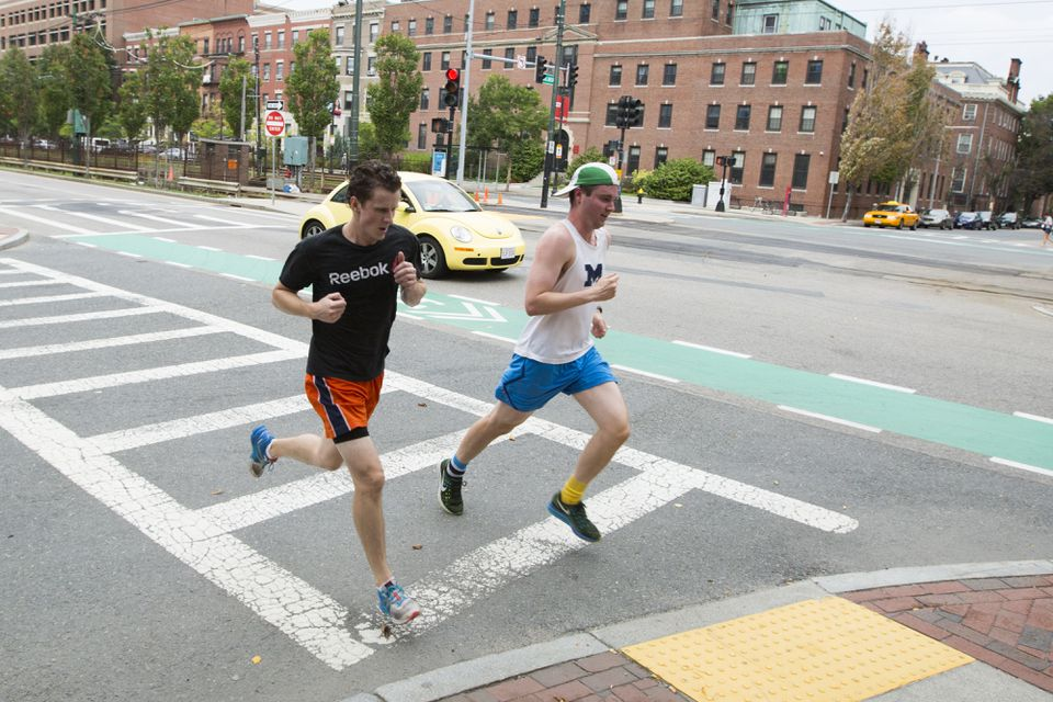 Alex Kittleberger and Will Gibbons ran along the train's route on Commonwealth Avenue from the Boston College stop to the Blanchford Street stop.