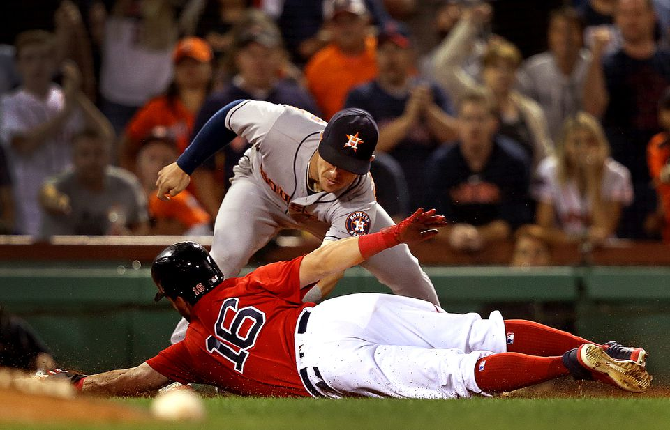Andrew Benintendi slid around the tag of Astros third baseman Alex Bregman to safely reach third base in the seventh inning.