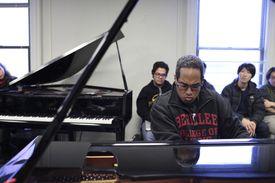 Perez playing in his Berklee classroom.