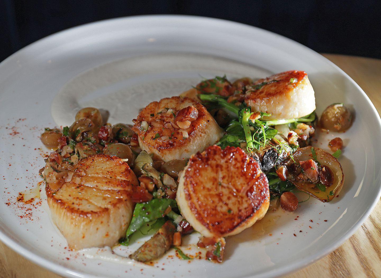 The New Bedford sea scallops, which includes artichokes, vidalia onions, grape, and almond salsa verde.