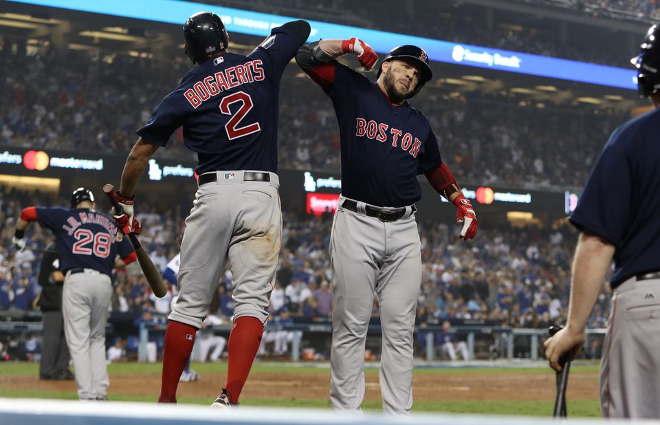 Steve Pearce celebrates with Xander Bogaerts after his homer tied the game, 4-4, in the eighth.