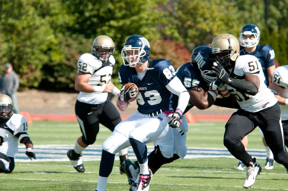 Hogan carried the ball during a 2010 game against Bryant. He had 12 catches for 147 yards in his season at Monmouth, and also had 28 tackles on defense.