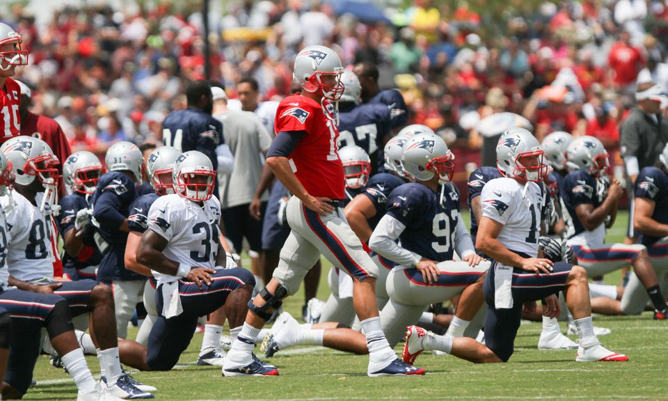 Tom Brady (center, in red) led the Patriots through another day of drills in Richmond, Va., Tuesday.