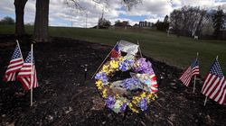 Flags, wreaths, and words of remembrance and love on the grounds of the Holyoke Soldiers' Home.