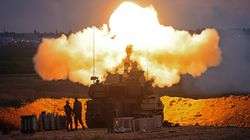 Israeli soldiers fire a 155mm self-propelled howitzer towards the Gaza Strip from their position along the border with the Palestinian enclave on Monday.