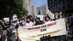 Protesters march through downtown as part of a youth organized Juneteenth demonstration Friday, June 19, 2020, in Providence,
