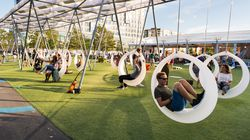The giant solar-powered LED swings on the Lawn on D change colors when swung, fun for kids and adults alike.