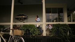 A wraparound porch offers some of the outdoor seating at Groundswell Cafe + Bakery.