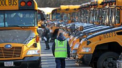 Busses return to the school bus lot on Freeport Street after a morning run to the city's schools on March 9.