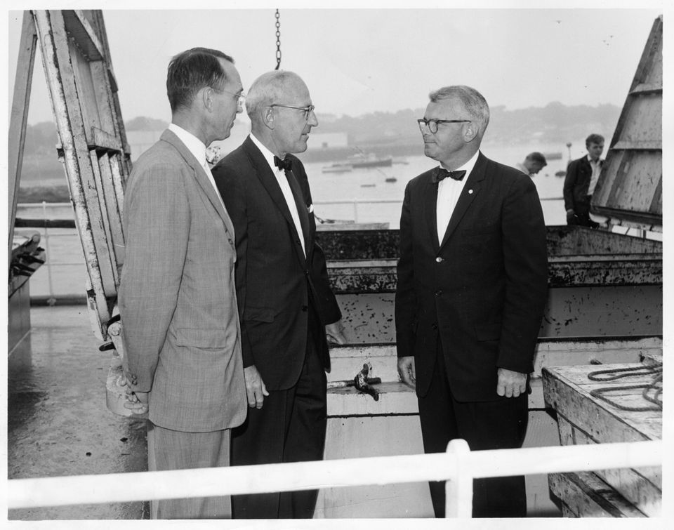 From left, Gorton's executives Havey H. Bundy Jr. and Paul M. Jacobs with E. Robert Kinney during a fishing boat inspection off Gloucester in 1965.