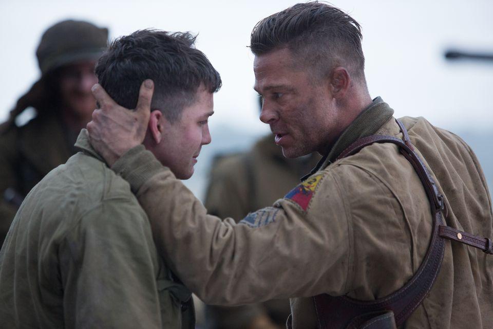 "Brad Pitt as Sergeant ""War-daddy"" Collier and Logan Lerman as a new recruit."