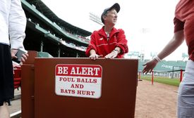 Signs at Fenway Park warn of foul balls and errant bats.