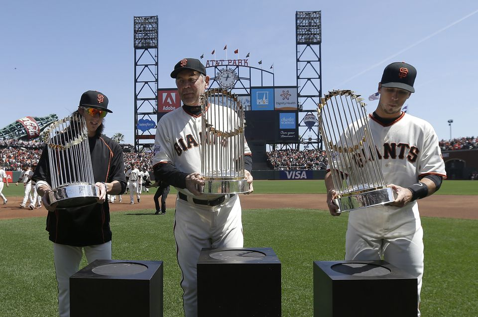 Bruce Bochy, shown between Tim Lincecum and Buster Posey in April 2015, helmed the Giants to their only three world championships since moving from New York for the 1958 season.