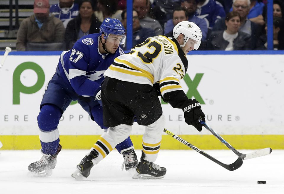 Tampa Bay defenseman Ryan McDonagh (27) knocks the puck away from Bruins center Jakob Forsbacka Karlsson during the second period Thursday.