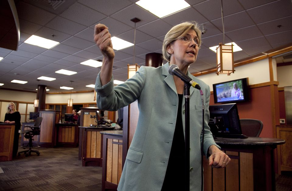 Elizabeth Warren responded to questions from reporters at Liberty Bay Credit Union headquarters in Braintree Wednesday.